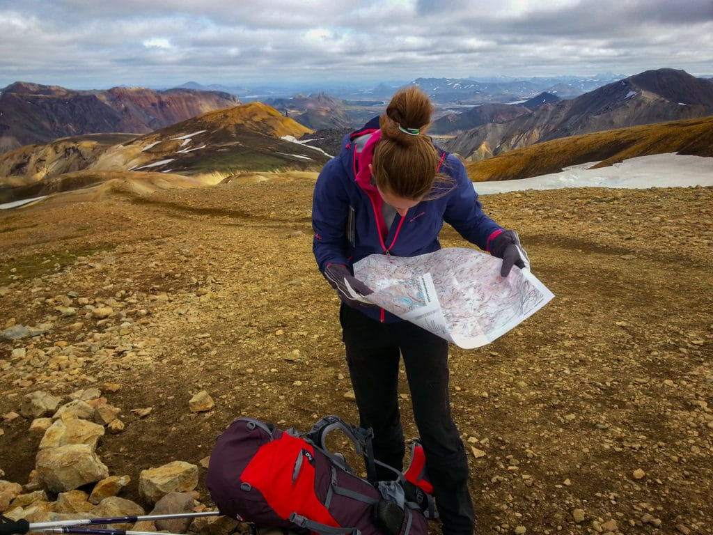 Jen trying to read a map during Laugavegur Trek in Iceland