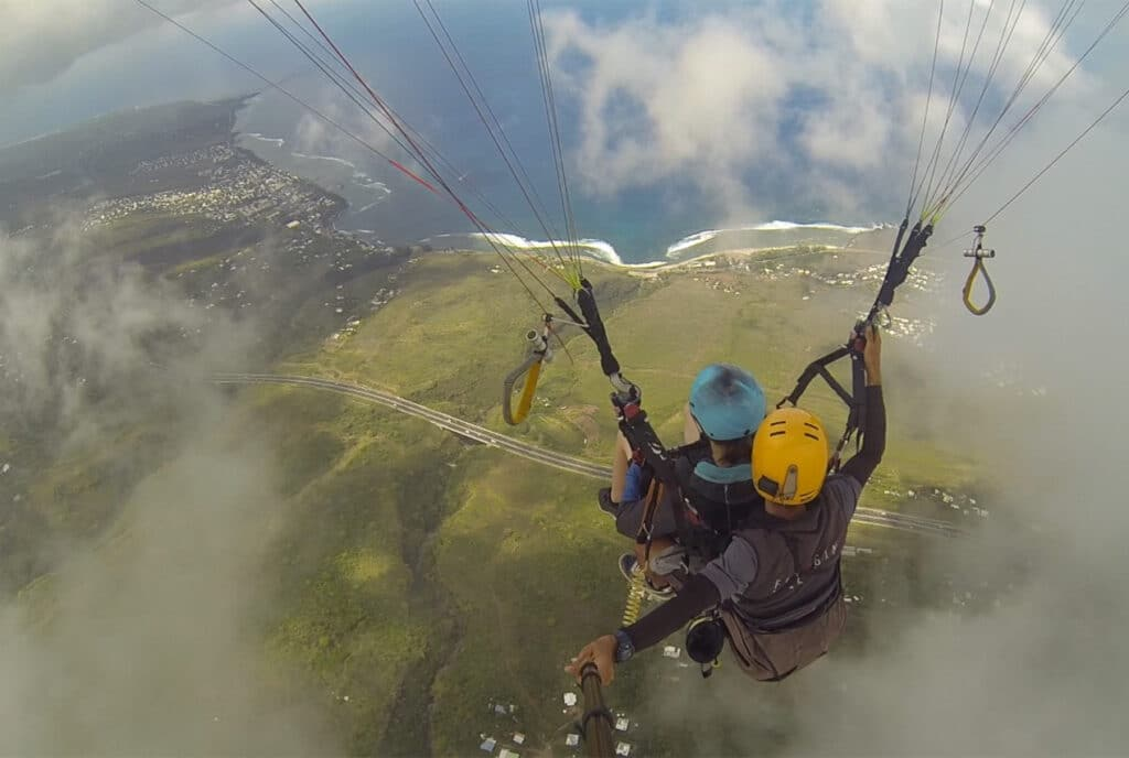 Emerging from the Clouds while Paragliding in Reunion Island