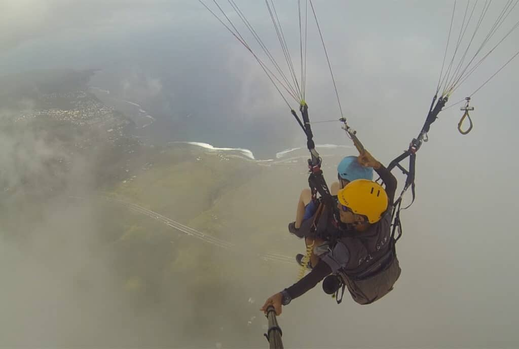 In Between the Clouds while Paragliding in Reunion Island