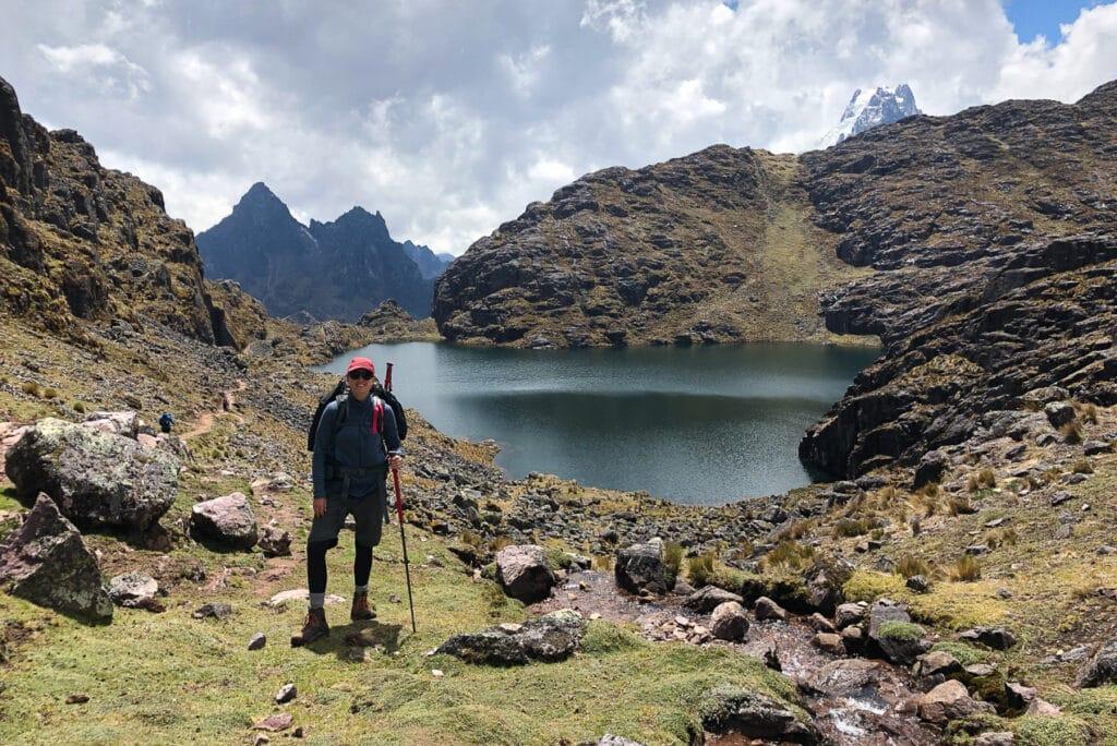 Jen from Dabbling in Jet Lag using her trekking Poles to hike uphill